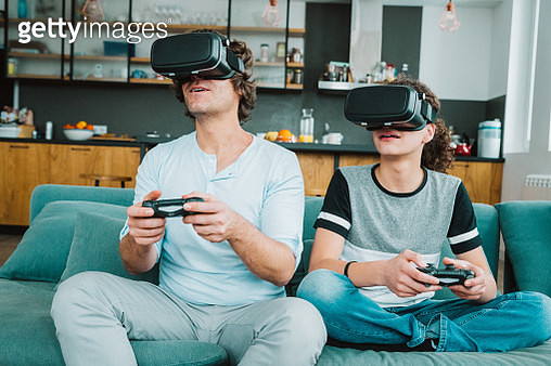 Father and son playing with VR - gettyimageskorea