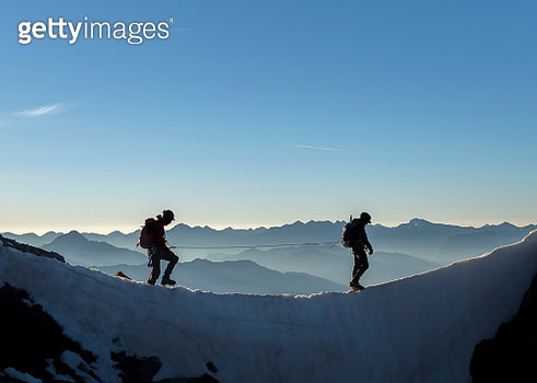 France, Ecrins Alps, two mountaineers at Dauphine - gettyimageskorea