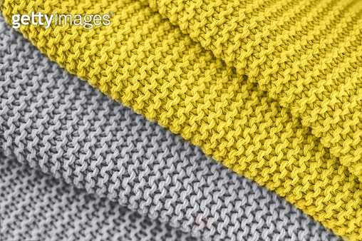 Knitted texture in yellow and gray colors. Close up. - gettyimageskorea