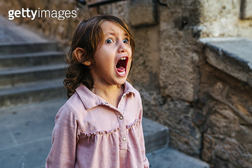 Lovely three year old girl very angry, screaming a sunny day a lot - gettyimageskorea