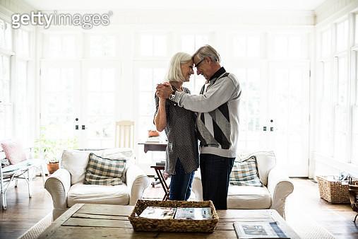 Senior couple dancing in living room - gettyimageskorea