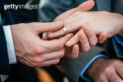 Gay Wedding Groom Placing Ring On Husband - gettyimageskorea