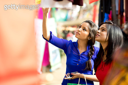 Indian women shopping at market - gettyimageskorea