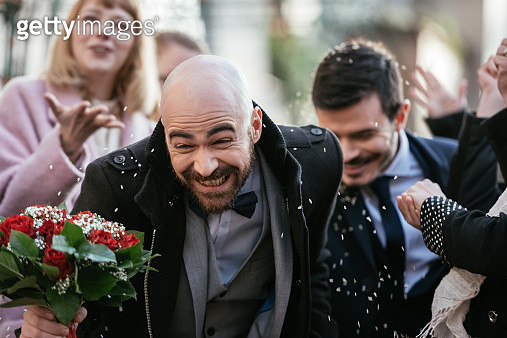 Throwing Rice On Gay Couple After Wedding Ceremony - gettyimageskorea