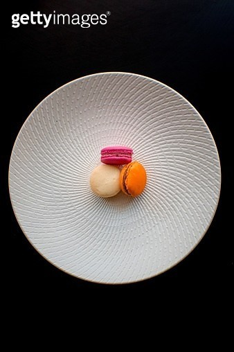 Close-Up Of Colorful Macaroons In Bowl Over Black Background - gettyimageskorea