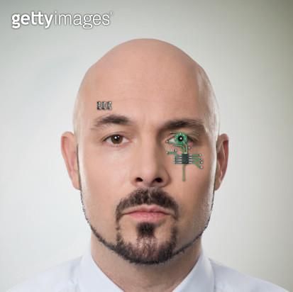 Man with computer chip in face - gettyimageskorea