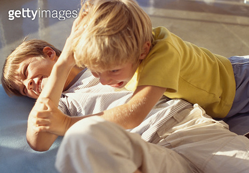 Two boys fighting on the floor - gettyimageskorea