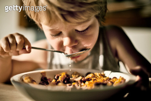 Child Eating Cereal - gettyimageskorea