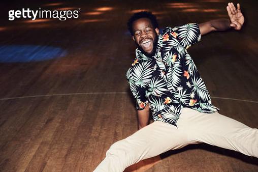 Man having fun at roller disco - gettyimageskorea