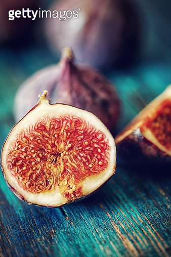 Fresh Sweet Figs on Wooden Background - gettyimageskorea