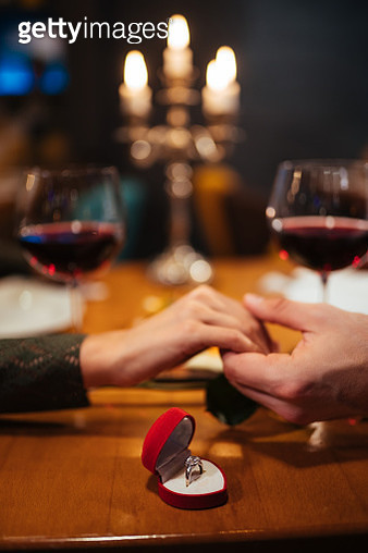 Couple holding hands in a restaurant - gettyimageskorea