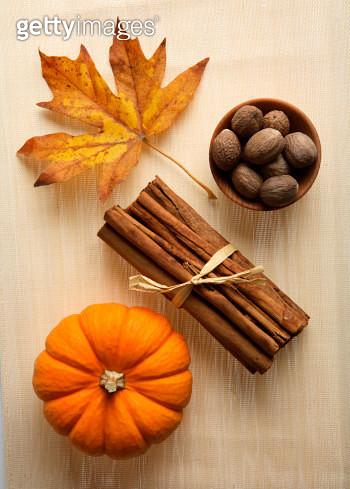 Fall still life with Maple leaf, Nutmeg, Cinnamon and Mini Pumpkin - gettyimageskorea