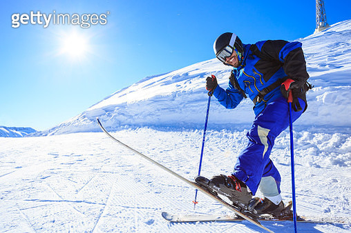 Skier on top of mountain - gettyimageskorea