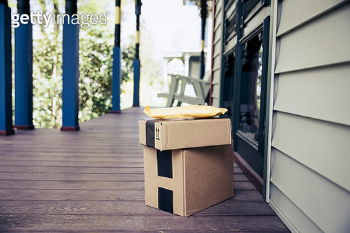 Stack of packages on front porch after mail delivery - gettyimageskorea