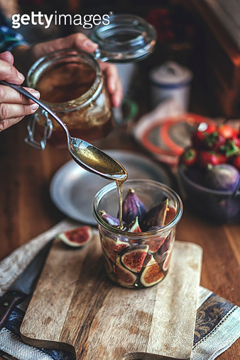 Preserving Figs with Honey in Jars - gettyimageskorea