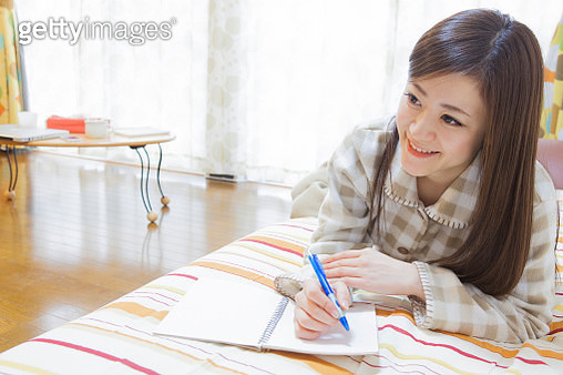 Japanese woman to the writing in bed - gettyimageskorea