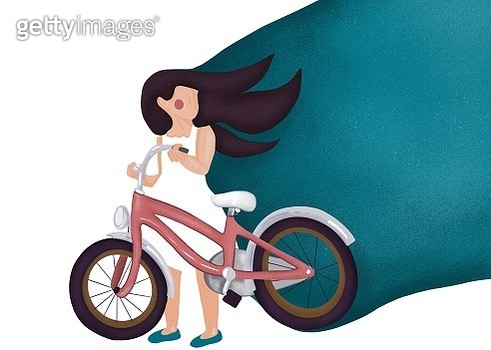 Young girl learning to ride a bike - gettyimageskorea