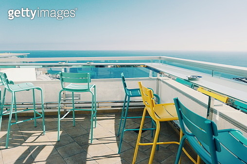 High Angle View Of Chairs Arranged By Sea Against Clear Sky During Sunny Day - gettyimageskorea
