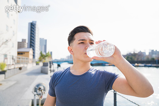 Young man drinking water - gettyimageskorea