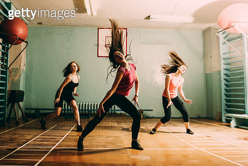Caucasian dancers rehearsing in gym - gettyimageskorea