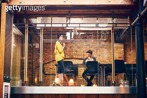 Two employees work on a project in modern office - gettyimageskorea