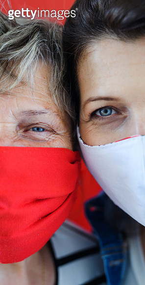 Midsection of woman and senior mother with face mask, quarantine concept. - gettyimageskorea