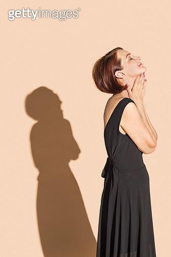 Serene woman in black dress - gettyimageskorea