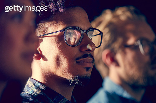 A mixed race male employee watches presentation - gettyimageskorea