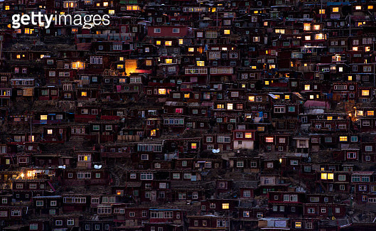 Ten of thousands monks and nuns live in these red log cabins in Seda Larong Wuming Buddhist Institute, the largest and most influential center for the study of Tibetan Buddhism in the world, situated in Larung valley, Seda county, Garze (Ganzi) Tibetan Au - gettyimageskorea