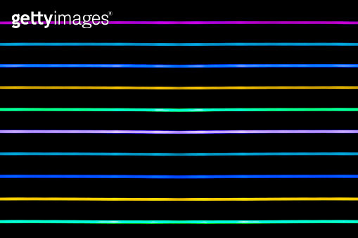 Close-up abstract pattern of intertwined colorful light beams of colors red, green and blue on a  black background. - gettyimageskorea