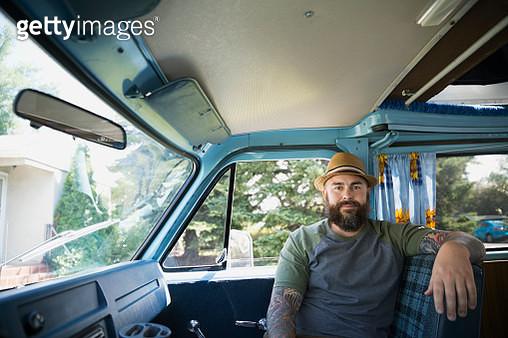 Portrait serious bearded man in van - gettyimageskorea