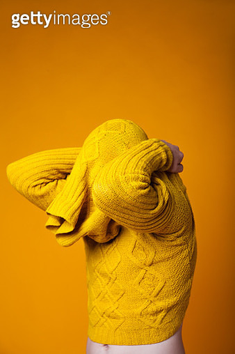 Man taking off sweater - gettyimageskorea