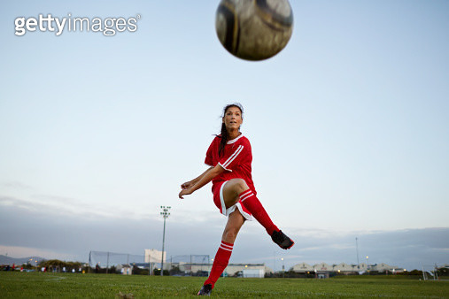 Female soccer player kicking the ball over camera - gettyimageskorea