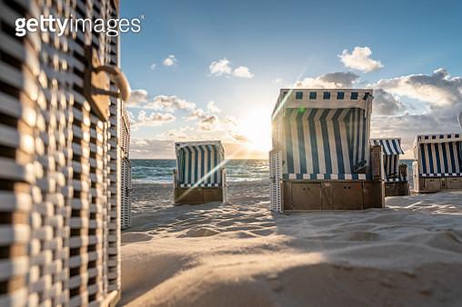 Hooded beach chairs (Strandkörbe) on the beach. - gettyimageskorea