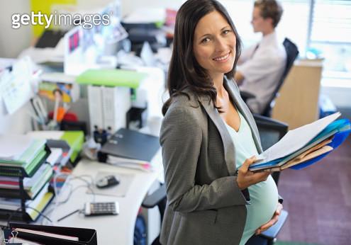 Pregnant businesswoman working in office - gettyimageskorea