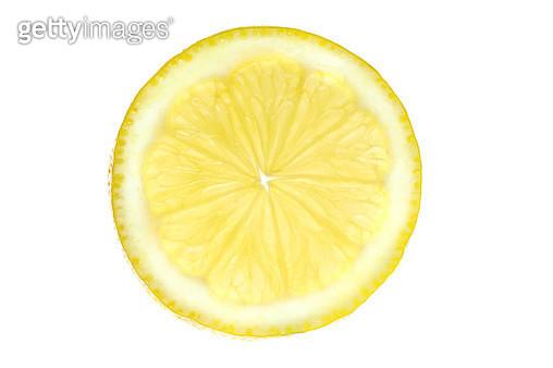 Close-Up Of Lemon Slice Against White Background - gettyimageskorea