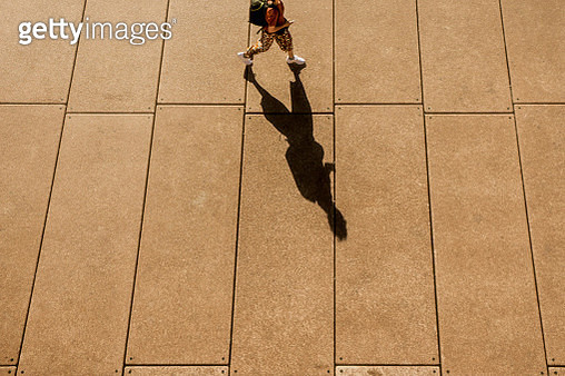A Long Shadow of a Person Walking - gettyimageskorea