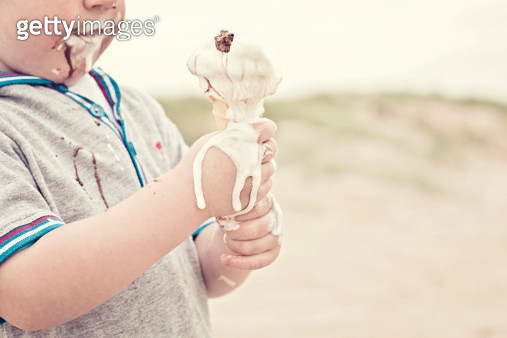 Child eating melted ice cream - gettyimageskorea