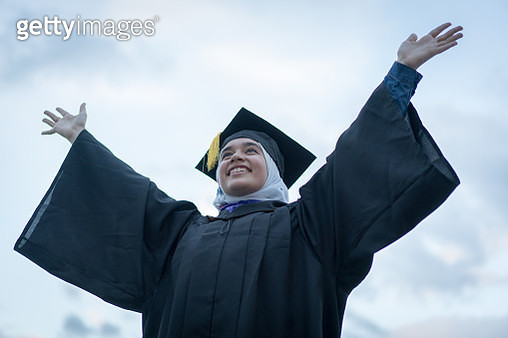 Muslim girl during graduation ceremony outdoors - gettyimageskorea