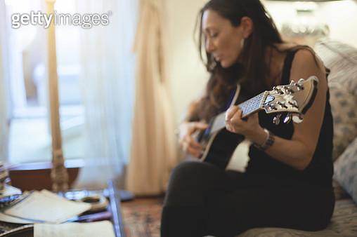 Woman playing guitar - gettyimageskorea