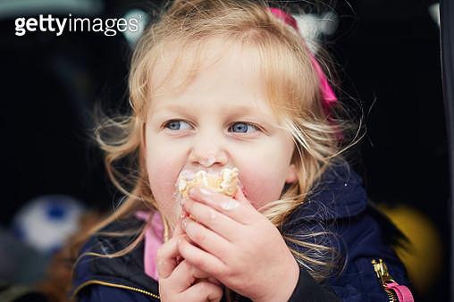 Happy little girl eating an ice cream - gettyimageskorea