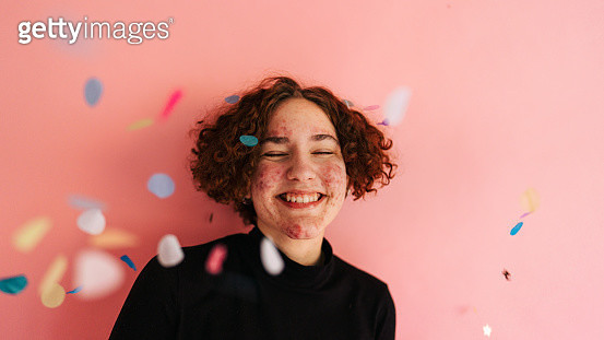 Portrait of a happy, cheerful teenage girl, celebrating on her own way. Studio shot, isolated. - gettyimageskorea