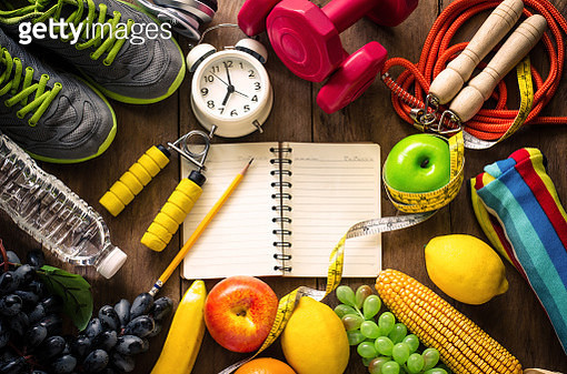 High Angle View Of Various Fruits With Exercise Equipment On Table - gettyimageskorea