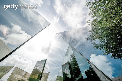Urban landscape reflected by polyhedral glass - gettyimageskorea