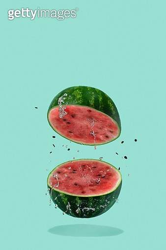 Watermelon sliced flying on pastel green background. Minimal fruit and summer concept. - gettyimageskorea