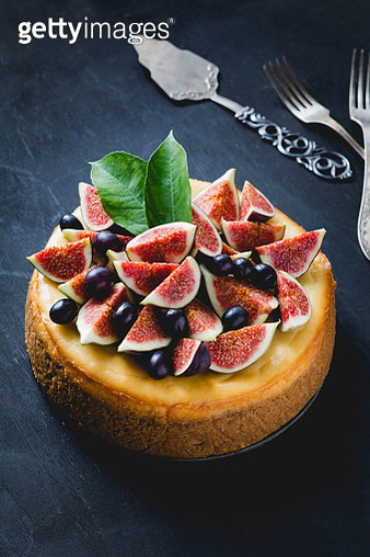 Cake decorated with figs and grapes - gettyimageskorea