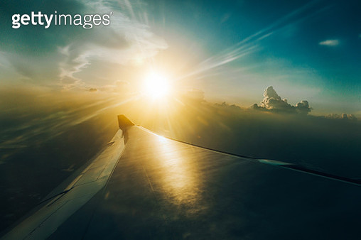 View looking from the airplane window at sky with beautiful sunbeam at sunrise - gettyimageskorea