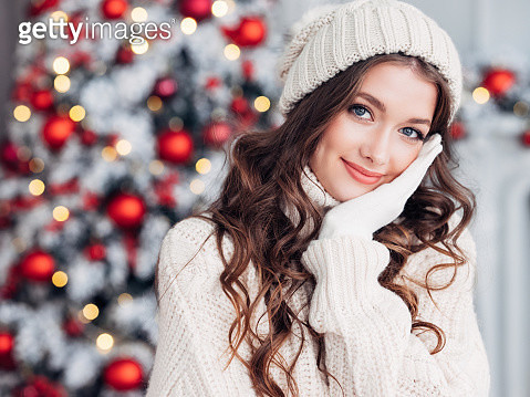 Beautiful woman in cozy Christmas atmosphere - gettyimageskorea