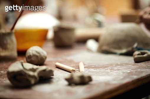 Scraping tools and clay in pottery workshop - gettyimageskorea