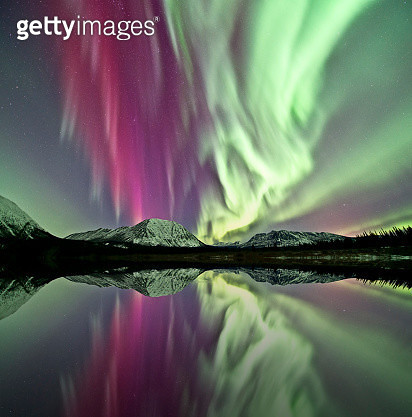 Northern lights above a lake in Yukon, Canada. - gettyimageskorea